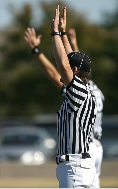 Soccer referee with hands up