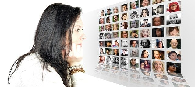 Woman looking at screen with profile pictures