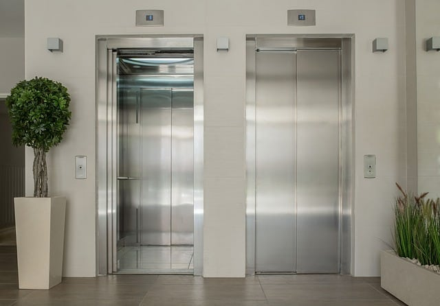 Two elevators and one has its doors open