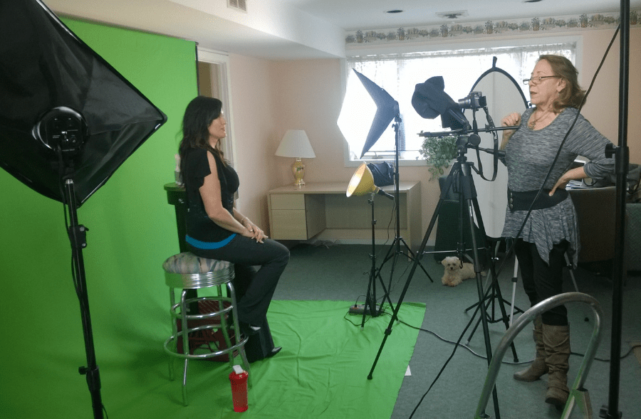 woman in front of green screen ready to shoot video