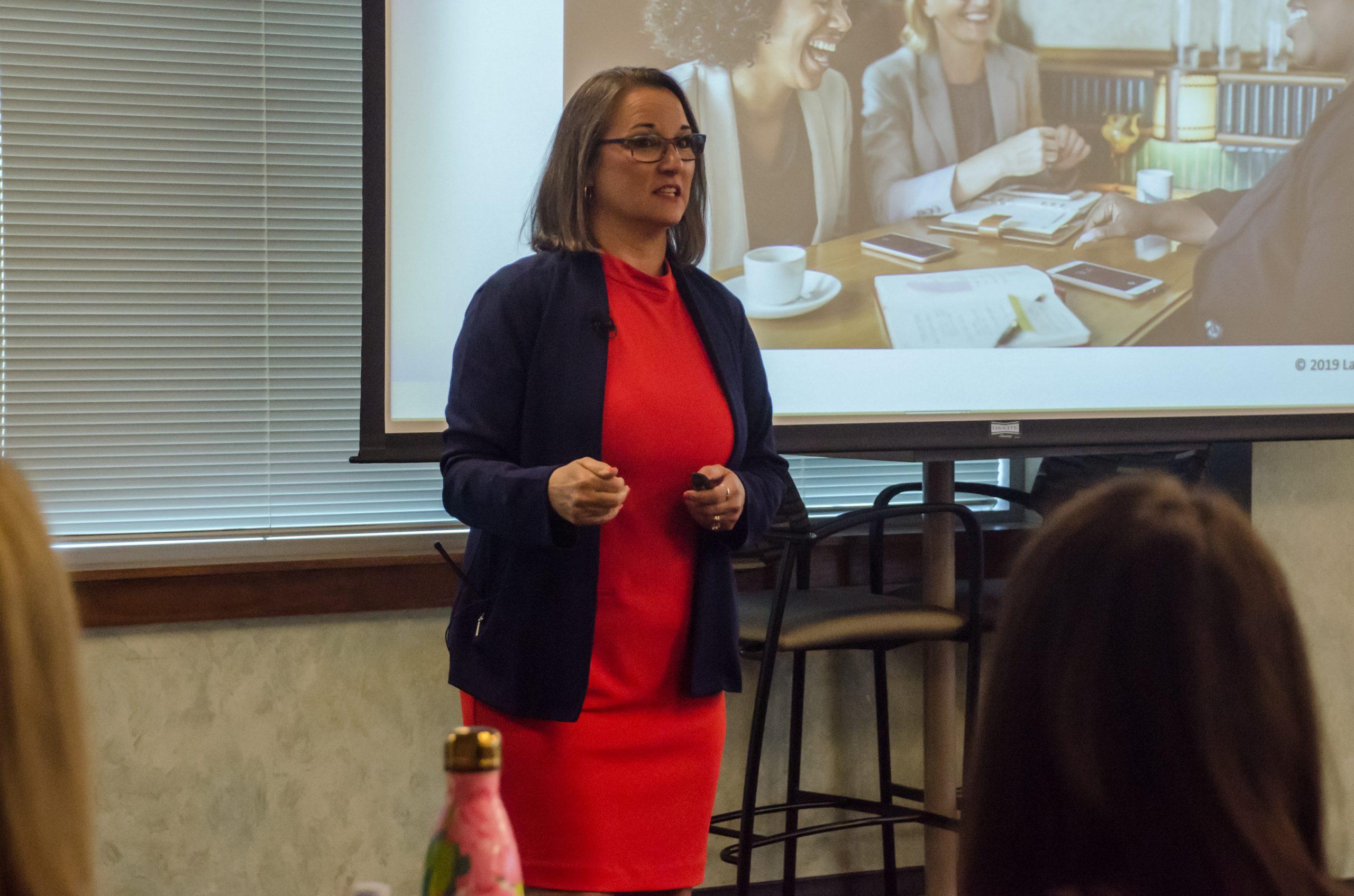Laura speaking to corportate